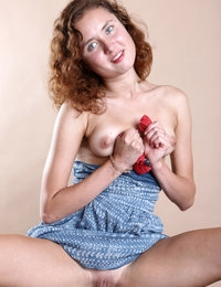 Curly sexy teen Flora spreading her long legs