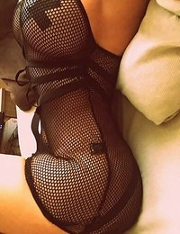 Katherine takes some hot selfies in a black fishnet dress